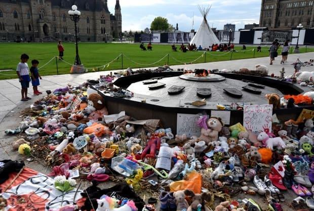 A memorial for children who died at residential schools is seen at the Centennial Flame on Parliament Hill in Ottawa. (Justin Tang/The Canadian Press - image credit)
