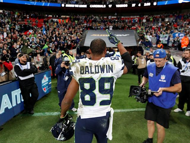 Doug Baldwin salutes the Wembley crowd as he leaves the field: Action Images via Reuters
