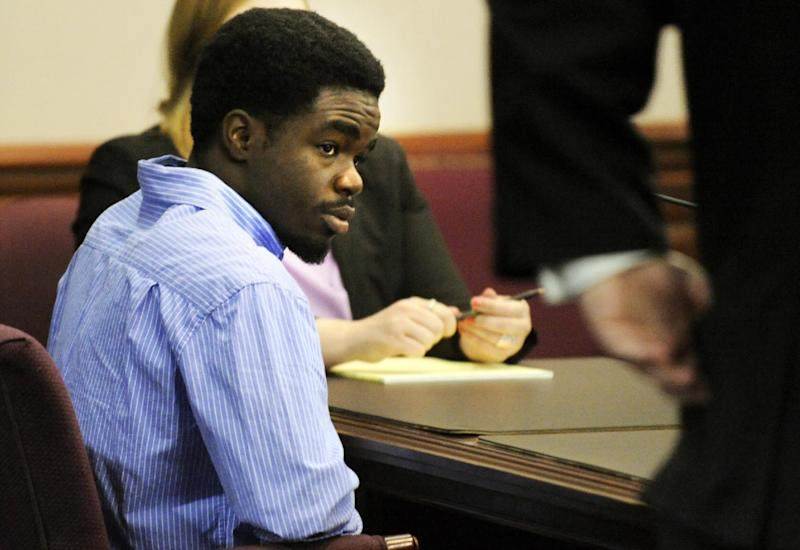 De'Marquise Elkins, center, listens to proceedings during his bond hearing while sitting next to his lawyer Defense Attorney Kevin Gough, right, Friday April 5, 2013 in Brunswick, Ga. Authorities charged Elkins with malice murder for the March 21 slaying of 13-month-old Antonio Santiago.  Police say the child was shot as Elkins and a younger teenager tried to rob the boy's mother. The judge denied Elkins' request for bond Friday, saying he's concerned Elkins might flee. (AP Photo/Stephen Morton)