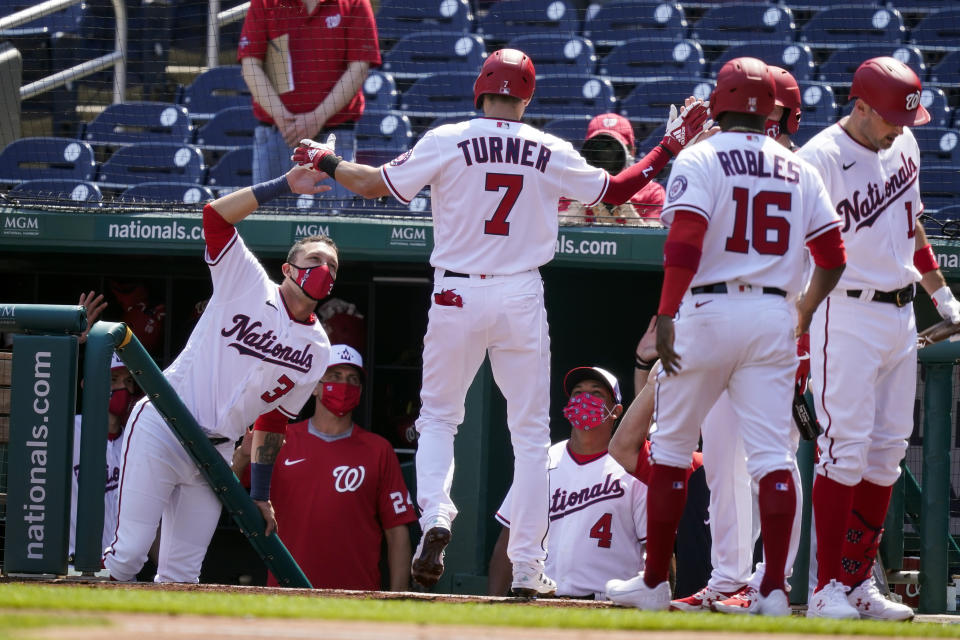 Washington Nationals' Trea Turner celebrates his two-run homer during the first inning in the first baseball game of a doubleheader against the Atlanta Braves at Nationals Park, Wednesday, April 7, 2021, in Washington. (AP Photo/Alex Brandon)