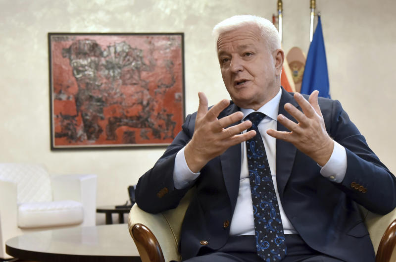 Montenegro's Prime Minister Dusko Markovic speaks during an interview with The Associated Press in Montenegro's capital Podgorica, Friday, Oct. 18, 2019. Markovic said that once Britain's Brexit split with Europe is all wrapped up, it would herald ''new opportunities for candidate countries'' to join the bloc, such as Montenegro, the Adriatic nation of some 600,000 people which is seeking EU membership. (AP Photo/Risto Bozovic)