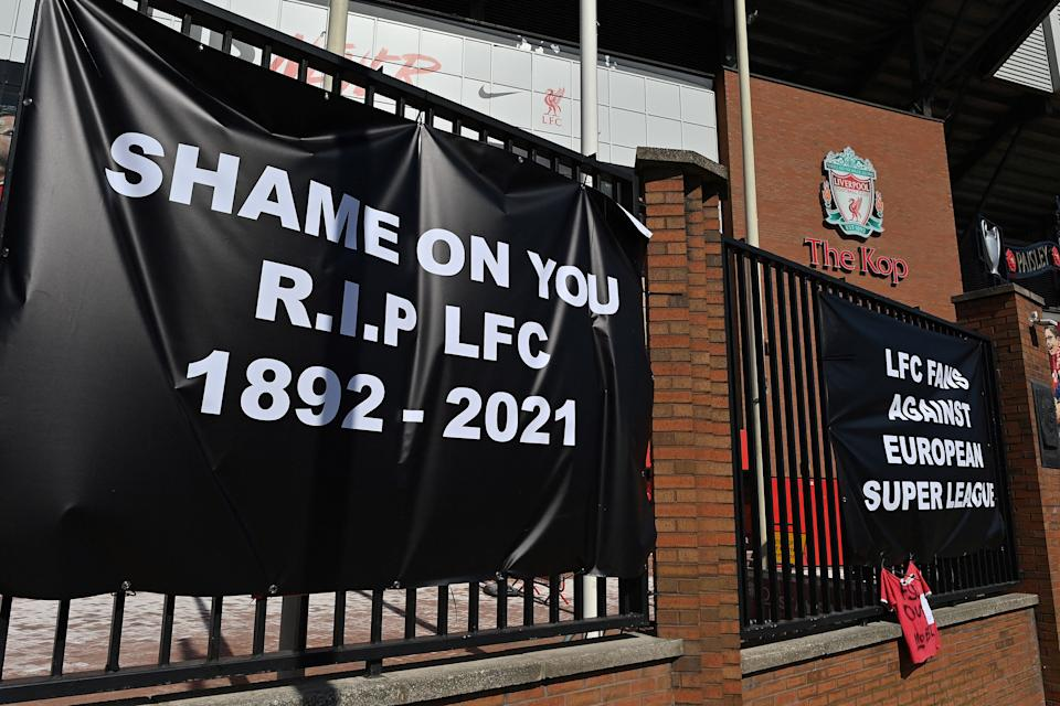 Anti-European Super League posters hang outside Anfield stadium, home of English Premier League football club Liverpool, in Liverpool, north west England on April 19, 2021. - Fan of the six Premier League clubs leading the breakaway European Super League have slammed the controversial plan, branding it the