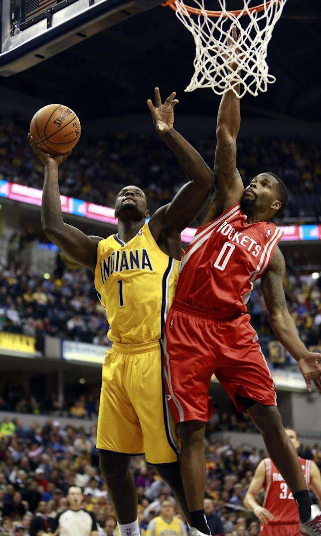 Indiana Pacers guard Lance Stephenson (1) shoots the basketball defended by Houston Rockets guard Aaron Brooks (0) in the second half of an NBA basketball game in Indianapolis, Friday, Dec. 20, 2013. Indiana won 114-81. (AP Photo/R Brent Smith)