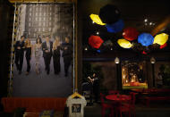 """A portrait of the cast of """"Friends"""" hangs in the """"Central Perk Cafe"""" installment at the Warner Bros. Studio Tour Hollywood media preview on June 24, 2021, in Burbank, Calif. (AP Photo/Chris Pizzello)"""
