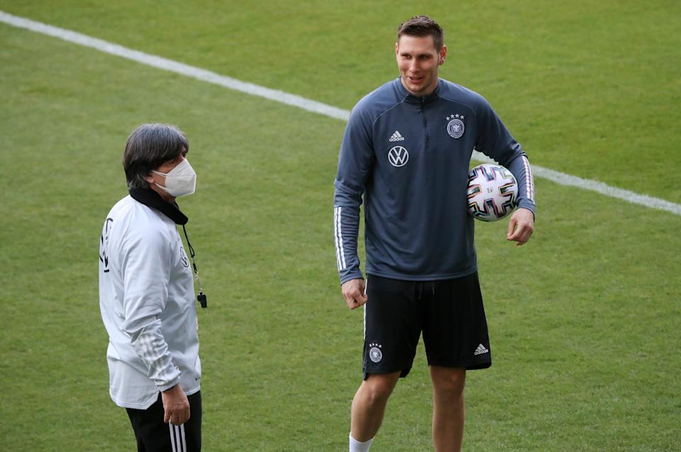Soccer Football - World Cup Qualifiers Europe - Germany Training - Schauinsland-Reisen-Arena, Duisburg, Germany - March 24, 2021  Germany coach Joachim Low and Niklas Sule during training REUTERS/Wolfgang Rattay