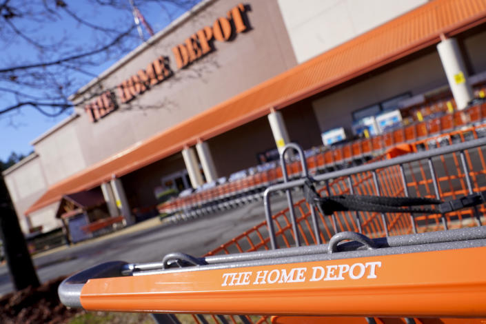 Shopping carts are lined up at The Home Depot store on Monday, Feb. 22, 2021, in Cornelius, N.C. The Home Depot's fiscal fourth-quarter sales surged 25% as the home improvement chain continues to meet the demands of consumers stuck at home and a resilient housing market. (AP Photo/Chris Carlson)