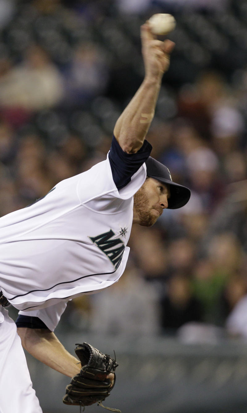 Seattle Mariners starting pitcher Doug Fister throws against the Oakland Athletics in the first inning of a baseball game Sunday, April 24, 2011, in Seattle. (AP Photo/Elaine Thompson)