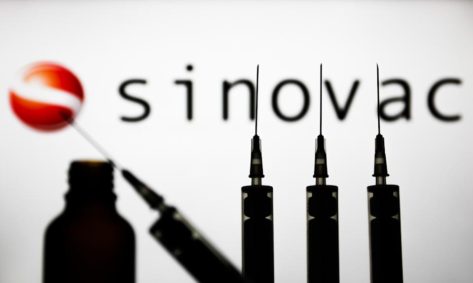 FILE PHOTO: Medical syringes are seen with Sinovac company logo displayed on a screen in the background in this illustration photo taken in Poland on November 15, 2020. (Photo: Jakub Porzycki/NurPhoto via Getty Images)