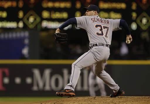 Detroit Tigers starting pitcher Max Scherzer throws in the fourth inning of a baseball game against the Seattle Mariners, Wednesday, April 17, 2013, in Seattle. (AP Photo/Ted S. Warren)