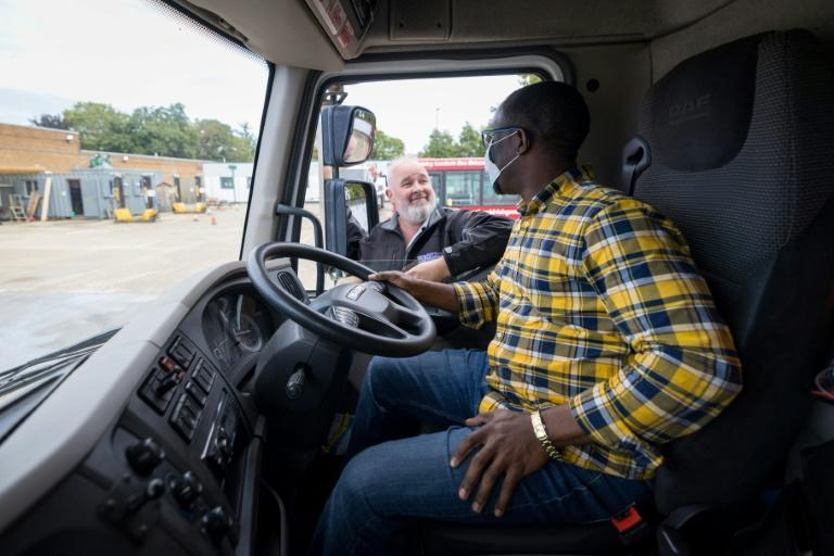 Pay and conditions for lorry drivers in Britain have put off new recruits (AFP/Tolga Akmen)