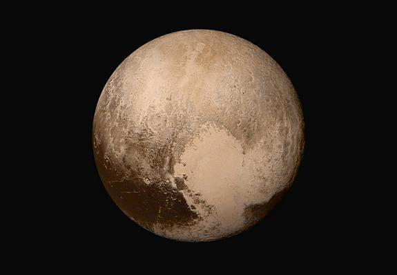 The dwarf planet Pluto is seen in true color in this stunning four-image mosaic created by photos from NASA's New Horizons spacecraft during the probe's historic flyby in July 2015. NASA unveiled the image on July 24.