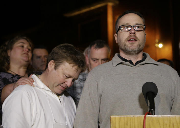 The brothers of slain Houston police officer Guy Gaddis, Edwin, left, and Gary, address the media outside the prison walls after witnessing the execution of Mexican national Edgar Tamayo Wednesday, Jan. 22, 2014, in Huntsville, Texas. Tamayo was convicted of killing Gaddis 20 years ago. (AP Photo/Pat Sullivan)