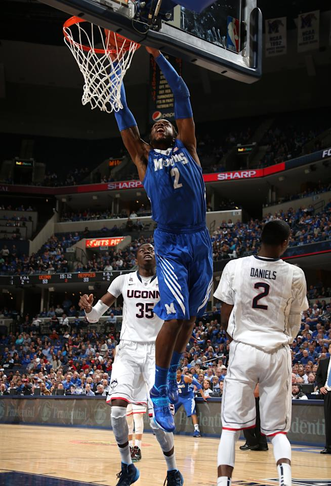 MEMPHIS, TN - MARCH 13: Shaq Goodwin #2 of the Memphis Tigers goes up for a dunk against DeAndre Daniels #2 of the Connecticut Huskies during the quarterfinal round of the American Athletic Conference Tournament at FedExForum on March 13, 2014 in Memphis, Tennessee. Connecticut defeated Memphis 72-53. (Photo by Joe Murphy/Getty Images)