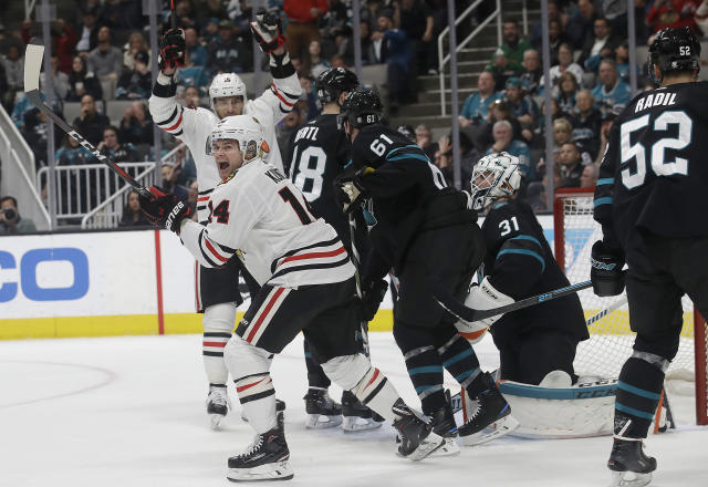Chicago Blackhawks left wing Chris Kunitz, foreground left, celebrates after scoring a goal against the San Jose Sharks during the second period of an NHL hockey game in San Jose, Calif., Thursday, March 28, 2019. (AP Photo/Jeff Chiu)