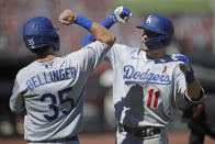 Los Angeles Dodgers' A.J. Pollock, right, celebrates with teammate Cody Bellinger (35) after hitting a two-run home run off San Francisco Giants' Andrew Suarez in the seventh inning of the first game of a baseball doubleheader Thursday, Aug. 27, 2020, in San Francisco. (AP Photo/Ben Margot)