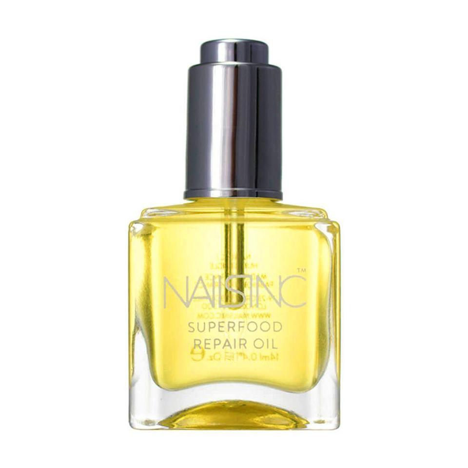 """<p><strong>NAILS INC.</strong></p><p>nailsinc.com</p><p><strong>$12.00</strong></p><p><a href=""""https://go.redirectingat.com?id=74968X1596630&url=https%3A%2F%2Fwww.nailsinc.com%2Fus%2Fsuperfood-repair-oil-for-nails&sref=https%3A%2F%2Fwww.bestproducts.com%2Fbeauty%2Fg2709%2Fbest-cuticle-oils-for-cuticle-care%2F"""" rel=""""nofollow noopener"""" target=""""_blank"""" data-ylk=""""slk:Shop Now"""" class=""""link rapid-noclick-resp"""">Shop Now</a></p><p>Massage a few drops of this oil onto your nails and cuticles to feed them with nutrients. Sweet almond oil, argan oil, and rose hip oil work together to stop skin from peeling and cracking, and promote healthy nail growth. </p>"""