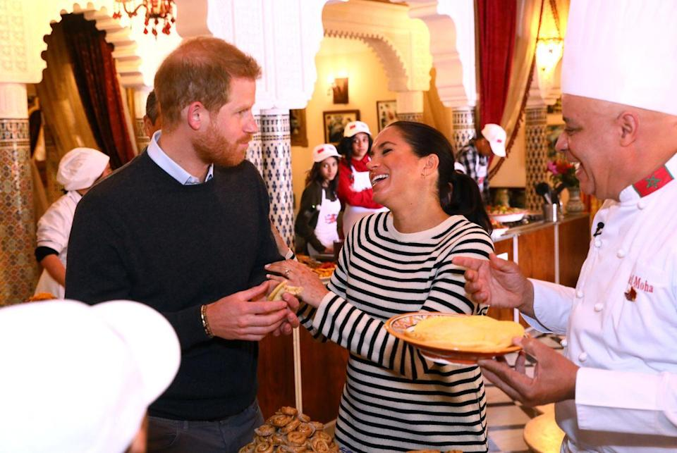<p>Markle laughed after her husband took a huge bite of food whilst on their Royal Tour. </p>