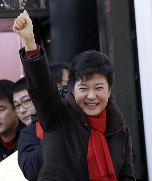 South Korea's presidential candidate Park Geun-hye of ruling Saenuri Party pumps her fist in the air during her presidential election campaign in Suwon, south of Seoul, South Korea, Monday, Dec. 17, 2012. South Korea's presidential election is scheduled for Dec. 19. (AP Photo/Lee Jin-man)