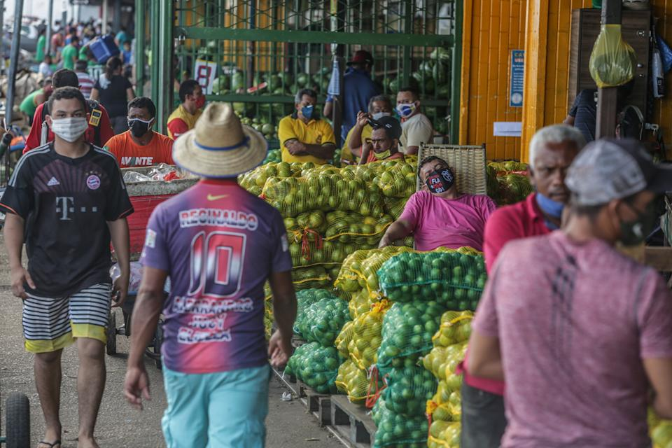 MANAUS, BRAZIL - MAY 20: Customers and vendors using protective masks at the Manaus Moderna market at Manaus port, on May 20 2020 in Manaus, Brazil. Most of fruits, vegetables and goods that arrive at Manaus are trade at this traditional market and sent all over the city. the coronavirus (COVID-19) pandemic.. (Photo by Andre Coelho/Getty Images)