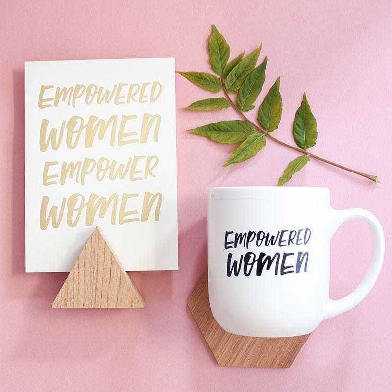 """Get it <a href=""""https://www.essellesf.com/collections/drinkware/products/new-limited-edition-empowered-women-print-mug"""" target=""""_blank"""">here</a>."""