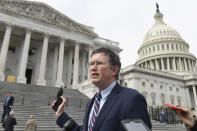 Rep. Thomas Massie, R-Ky., leaves Capitol Hill in Washington, Friday, March 27, 2020, after attempting to slow action on a rescue package. Despite Massie's effort and acting with exceptional resolve in an extraordinary time, the House rushed President Donald Trump a $2.2 trillion rescue package, tossing a life preserver to a U.S. economy and health care system left flailing by the coronavirus pandemic. (AP Photo/Susan Walsh)