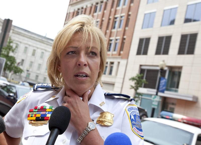 Washington Police Chief Cathy Lanier meets with reporters near the Family Research Council in Washington, Wednesday, Aug. 15, 2012, after a security guard for the lobbying group was shot in the arm. A police spokeswoman says the shooting happened Wednesday, at the headquarters of the Family Research Council. Police say one person has been taken into custody. (AP Photo/J. Scott Applewhite)