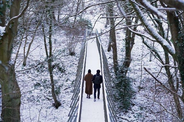 People walking through the snow at Pelaw Wood in Durham