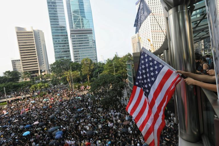 Hong Kong protesters march peacefully from Chater Garden to the US consulate, hoping to increase foreign pressure on Beijing (AFP Photo/Vivek Prakash)