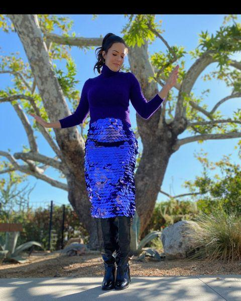 <p>Moore got all dressed up for a virtual appearance on <em>The Kelly Clarkson Show,</em> showing off her growing bump in a sparkling purple skirt and turtleneck.</p>