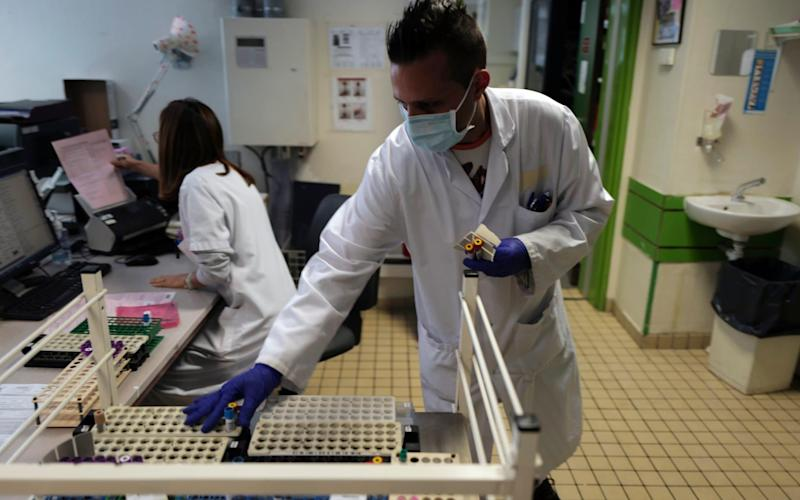 Health lab technician prepares samples to process analysis at the Hospital of Argenteuil, north of Paris, Friday Sept. 25, 2020. France's health agency announced Thursday evening that the country has had 52 new deaths and has detected over 16,000 new cases of coronavirus in 24 hours. (AP Photo/Francois Mori) - Francois Mori/AP