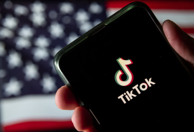 CHINA - 2020/08/11: In this photo illustration the Chinese video-sharing social networking service company, TikTok logo is seen on an Android mobile device with United States of America flag in the background. (Photo Illustration by Budrul Chukrut/SOPA Images/LightRocket via Getty Images)