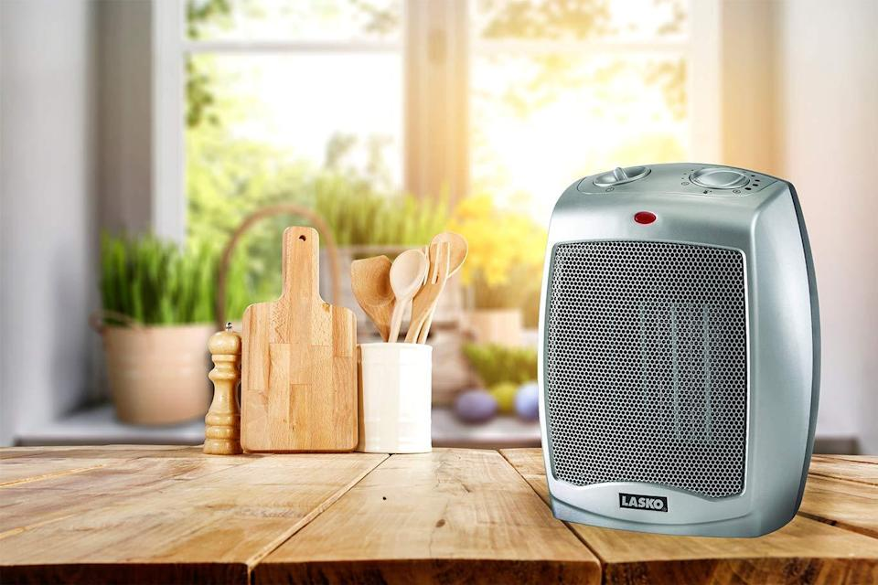 "<h2>Lasko Ceramic Portable Space Heater</h2><br>Compact, silent, and adjustable, this carry-sized Lasko space heater is perfect for keeping beneath your desk or beside your bed. <br><br><strong>The Hype:</strong> 4.5 out of 5 stars and 24,154 reviews on <a href=""https://www.amazon.com/Lasko-754200-Portable-Adjustable-Thermostat/dp/B000TKDQ5C"" rel=""nofollow noopener"" target=""_blank"" data-ylk=""slk:Amazon"" class=""link rapid-noclick-resp"">Amazon</a><br><br><strong>Warm People Say: </strong>""My wife and I are extremely pleased with this heater. It is attractive, has a very small footprint, and great safety and adjustability features. And does it ever put out the heat! The fan speed is adjustable and so is the heat intensity."" - <em>Gary C</em>, <em>Amazon reviewer </em><br><br><strong>Lasko</strong> Lasko Ceramic Portable Space Heater, $, available at <a href=""https://www.amazon.com/Lasko-754200-Portable-Adjustable-Thermostat/dp/B000TKDQ5C"" rel=""nofollow noopener"" target=""_blank"" data-ylk=""slk:Amazon"" class=""link rapid-noclick-resp"">Amazon</a>"