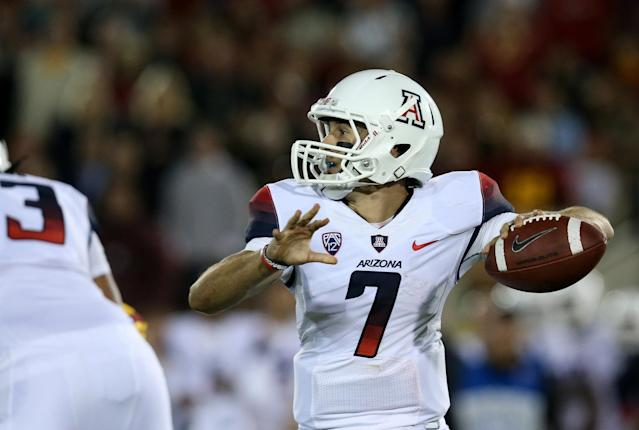 LOS ANGELES, CA - OCTOBER 10: Quarterback B.J. Denker #7 of the Arizona Wildcats throws a pass against the USC Trojans at Los Angeles Coliseum on October 10, 2013 in Los Angeles, California. (Photo by Stephen Dunn/Getty Images)