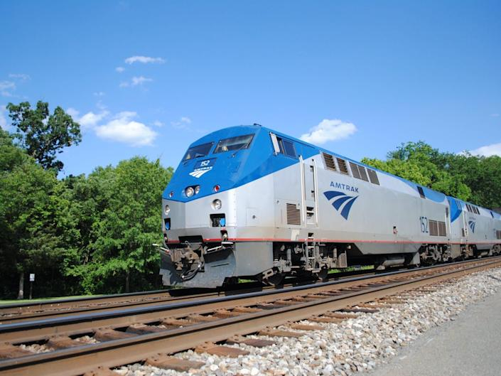 the exterior of an Amtrak long-distance train on the tracks