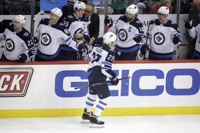 Winnipeg Jets' Nikolaj Ehlers (27) returns to the bench after scoring during the first period of an NHL hockey game against the Pittsburgh Penguins in Pittsburgh, Tuesday, Oct. 8, 2019. (AP Photo/Gene J. Puskar)
