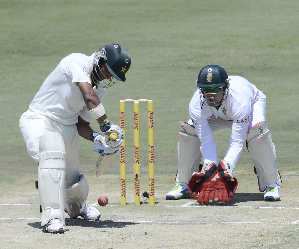 Pakistan Batsman Imran Farhat (L) plays a shot as South African wicketkeeper AB de Villiers waits to make a catch during  the third day of the third Test match between South Africa and Pakistan on February 24, 2013 at Super Sport Park in Centurion. AFP PHOTO / STEPHANE DE SAKUTIN        (Photo credit should read STEPHANE DE SAKUTIN/AFP/Getty Images)