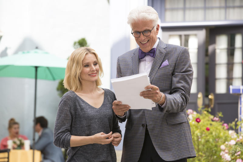 """This image released by NBC shows Kristen Bell as Eleanor, left, and Ted Danson as Michael in a scene from, """"The Good Place,"""" airing Thursdays at 8:30 p.m. EDT. (Justin Lubin/NBC via AP)"""