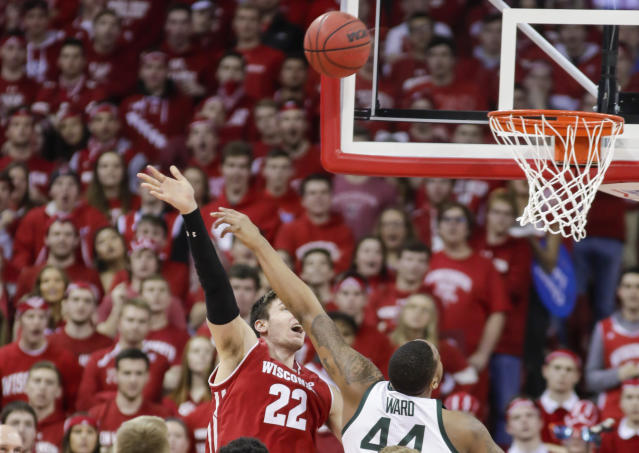 Wisconsin's Ethan Happ (22) and Michigan States's Nick Ward (44) watch Hap's shot during the first half of an NCAA college basketball game Tuesday, Feb. 12, 2019, in Madison, Wis. (AP Photo/Andy Manis)