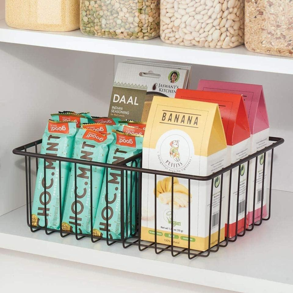 <p>This <span>MDesign Metal Kitchen Food Storage Container Lid Holder</span> ($15) is also great for storing small packaged foods.</p>