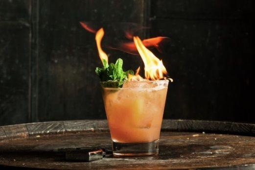 """<p><strong>Ingredients</strong></p><p>2 oz Maker's 46 bourbon<br>.75 oz lemon juice<br>.75 oz of grilled peach sherbet*<br>2-3 mint leaves for garnish</p><p><strong>Instructions</strong></p><p>Place all ingredients into a shaker over ice, shake, and strain into a rocks glass. Garnish with mint leaves and top off the drink with ground cinnamon, set cinnamon on fire if desred.</p><p><strong>*Grilled peach sherbet</strong><strong>:</strong> Grill 2-3 peaches (or any seasonal fruit) until nicely charred. Mix the peaches in a blender with equal parts white sugar and strain. Freeze or firm in an ice cream churn. </p><p><em>Created by </em><a href=""""https://www.instagram.com/masanyc/?hl=en"""" rel=""""nofollow noopener"""" target=""""_blank"""" data-ylk=""""slk:Masa Urushido"""" class=""""link rapid-noclick-resp""""><em>Masa Urushido</em></a></p><p><a class=""""link rapid-noclick-resp"""" href=""""https://go.redirectingat.com?id=74968X1596630&url=https%3A%2F%2Fwww.reservebar.com%2Fmakers-46-bourbon&sref=https%3A%2F%2Fwww.townandcountrymag.com%2Fleisure%2Fdrinks%2Fg2839%2Fhalloween-drinks%2F"""" rel=""""nofollow noopener"""" target=""""_blank"""" data-ylk=""""slk:Buy Now"""">Buy Now</a> <em>Maker's Mark Maker's 46, $41</em></p>"""