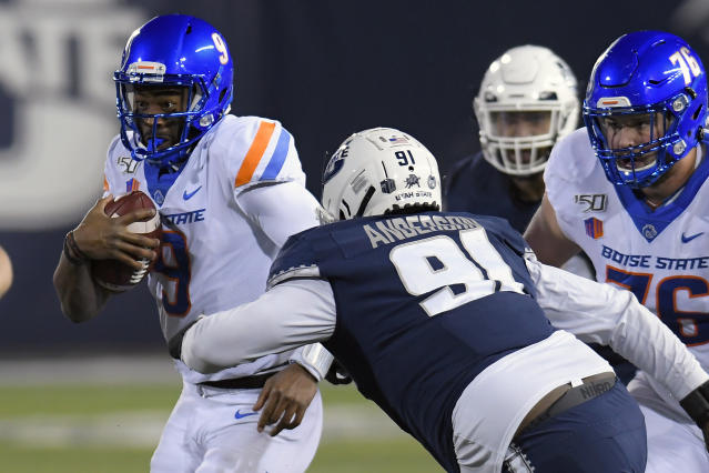 Boise State reached into its bag of tricks against Utah State. (AP Photo/Eli Lucero)