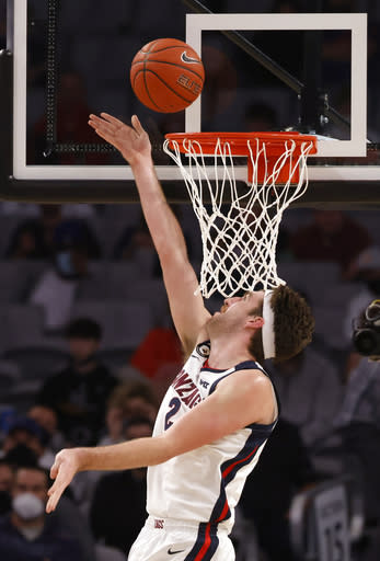 Gonzaga forward Drew Timme (2) scores inside against Virginia during the first half of an NCAA college basketball game, Saturday, Dec. 26, 2020, in Fort Worth, Texas. (AP Photo/Ron Jenkins)
