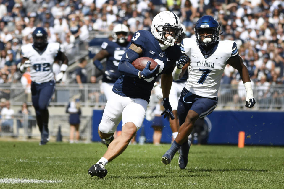 Penn State wide receiver Parker Washington (3) breaks away from Villanova defensive back Jalen Goodman (7) to score a first quarter touchdown during an NCAA college football game in State College, Pa., on Saturday, Sept. 25, 2021. (AP Photo/Barry Reeger)