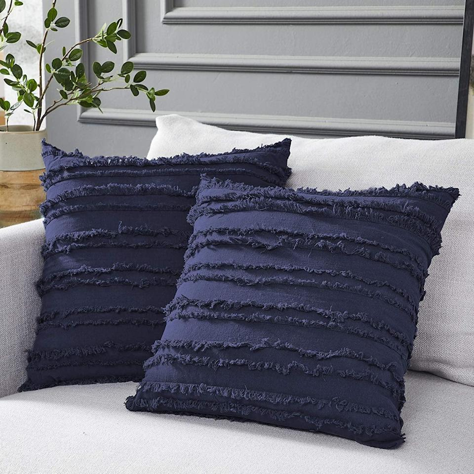 <p>We love the texture on these <span>Longhui bedding Throw Pillow Covers</span> ($15).</p>