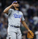 Los Angeles Dodgers relief pitcher Kenley Jansen gestures after striking out Colorado Rockies pinch-hitter Garrett Hampson for the final out of a baseball game Saturday, April 6, 2019, in Denver. The Dodgers won 7-2. (AP Photo/David Zalubowski)