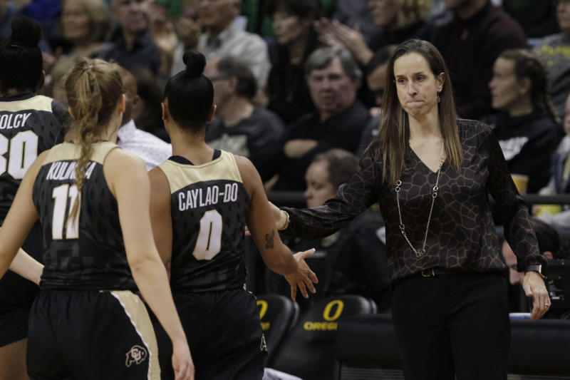 Colorado coach JR Payne, right, calls her team to the bench for a timeout during the fourth quarter of an NCAA college basketball game against Oregon in Eugene, Ore., Friday, Jan. 3, 2020. (AP Photo/Chris Pietsch)