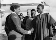 <p>The commercial air travel boom of the 1950s was not unique to the United States. Here, Nigerian prime minister Abubakar Tafawa Balewa greets stewardess Christina Twsela after the inaugural flight of the West African Airline Company. </p>