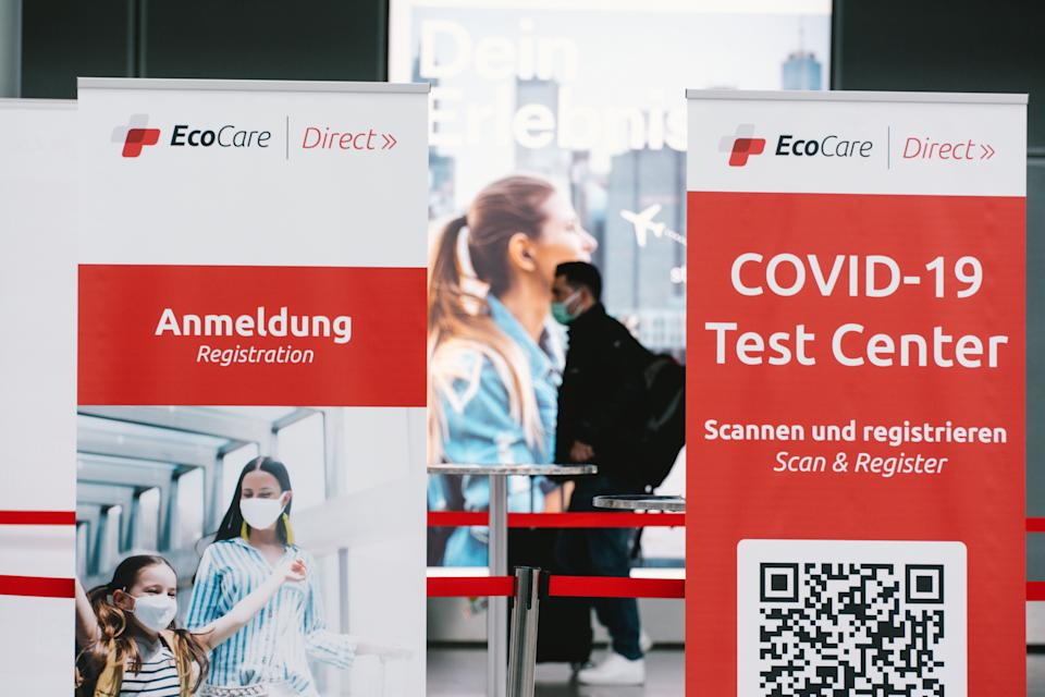 a man is seen walks pass a Coronavirus test center at Duessedorf airport, Germany on March 26, 2021 as airlines adds more flights to cope with surge in demand (Photo by Ying Tang/NurPhoto via Getty Images) (Photo: NurPhoto via Getty Images)