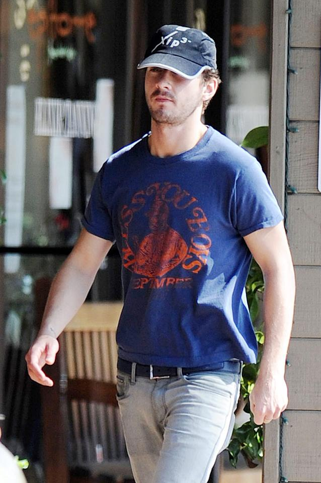 """Shia LaBeouf made sure not to crack a smile while being photographed Thursday in his vintage Detroit Tigers """"Bless You Boys"""" T-shirt. Richard Beetham/<a href=""""http://www.splashnewsonline.com/"""" target=""""new"""">Splash News</a> - March 4, 2010"""