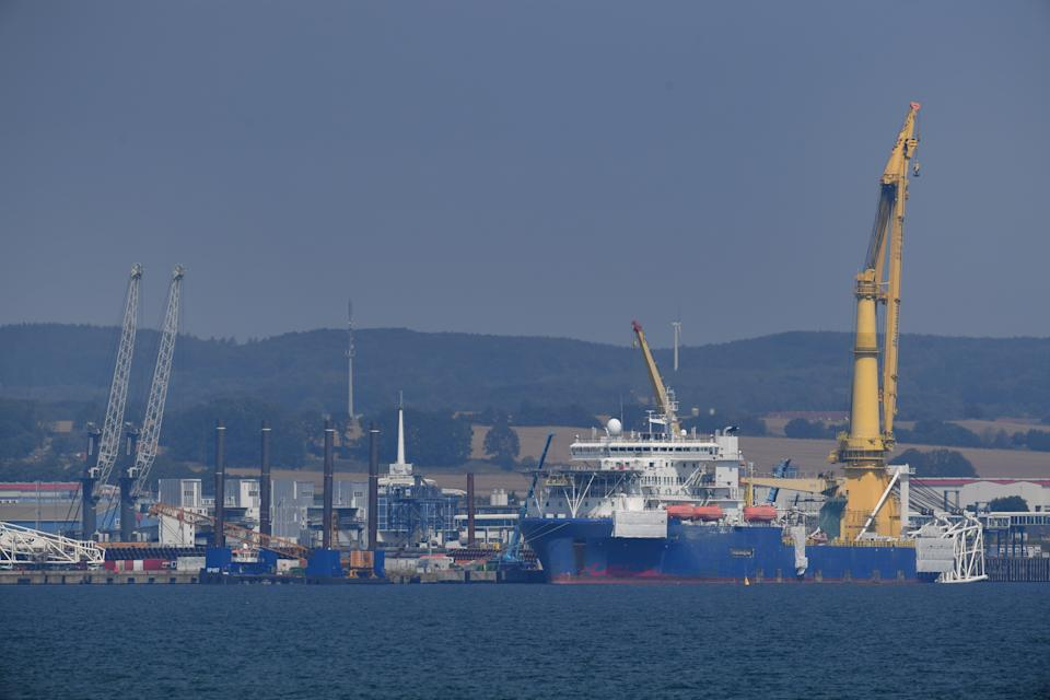 """10 August 2020, Mecklenburg-Western Pomerania, Sassnitz-Mukran: The Russian laying ship """"Akademik Tscherski"""" is moored in the port of Mukran on the island of Rügen. The special ship is being prepared in the port for its deployment for the further construction of the Nord Stream 2 Baltic Sea pipeline. Photo: Stefan Sauer/dpa-Zentralbild/dpa (Photo by Stefan Sauer/picture alliance via Getty Images)"""